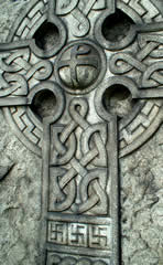 Celtic cross with swastikas at the base