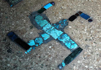Turquoise swastika on the temple floor in a Tibetan Buddhist monastery